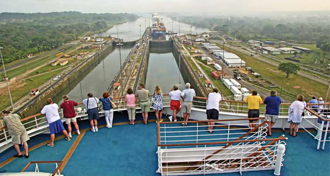 Passengers get a close-up look as their cruise ship enters the Panama Canal.