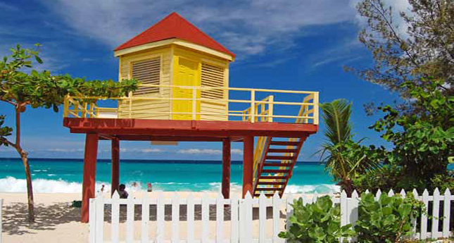 Yellow and red lifeguard booth on Grand Anse Beach, Grenada Island