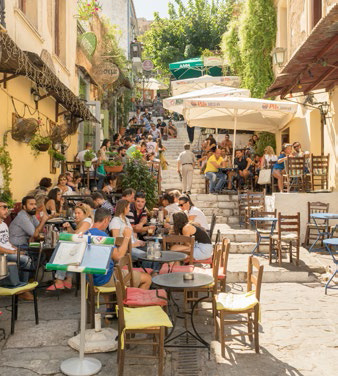 Tourists and locals drinking coffee in the Plaka district