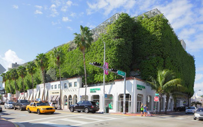 Eco-friendly parking garage and retail shops on Collins Avenue
