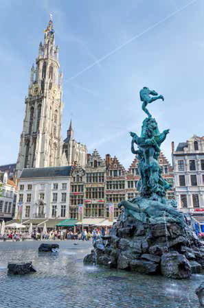 Tourists visit The Grand Place with the Statue of Brabo