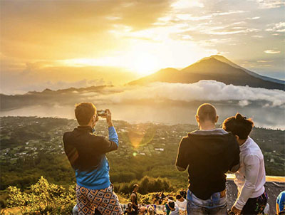 Photo op at dawn on top of the Mount Batur volcano