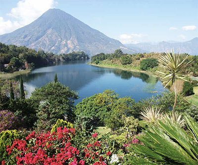 The volcano-ringed Lake Atitlan in the Highlands