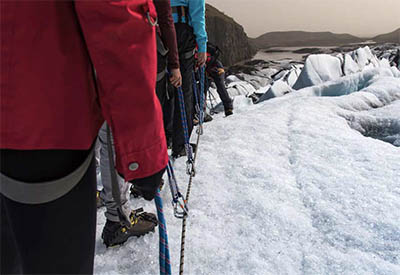 A group of people lined up for climbing