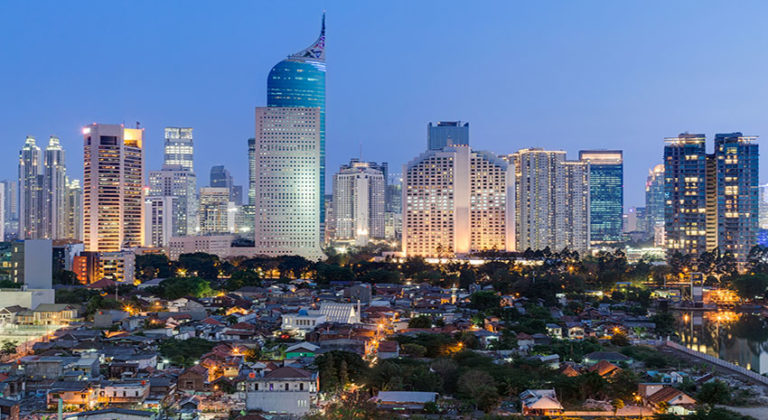 Jakarta downtown skyline with high-rise buildings at sunset