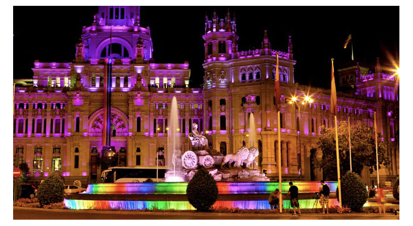 Madrid City Hall with rainbow-lighted fountain