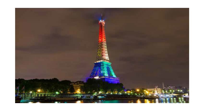 CITY LIGHTS: The Eiffel Tower lit up in colors of the rainbow flag in solidarity with the LGBTQ community