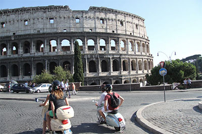 Exploring the Eternal City on Vespa scooters on a Discover Your Italy tour in Rome