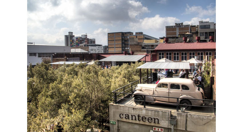 Rooftop bar with an old car in Arts on Main, Maboneng Precinct