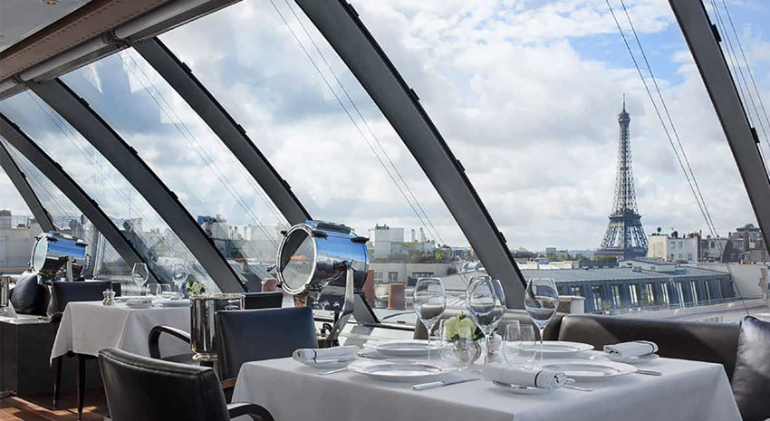 View of the Eiffel Tower from The Peninsula Paris L'Oiseau Blanc rooftop dining room.
