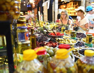 Assortment of marinated olives at a stall in Sarona Gastro Market