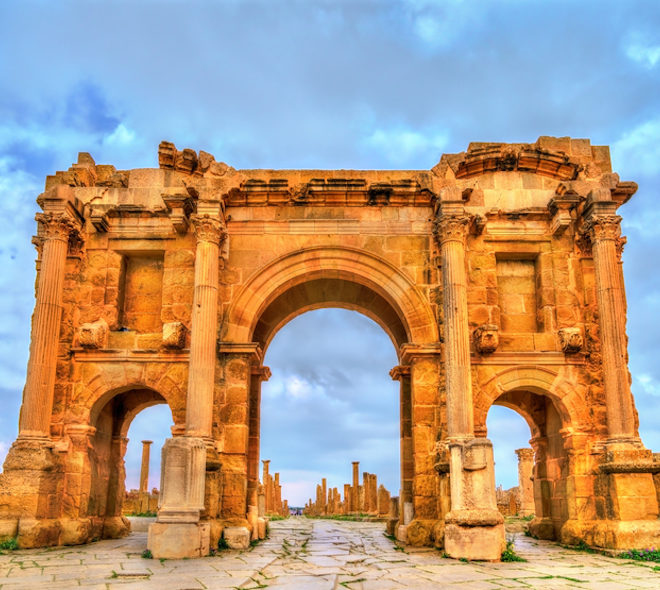 Trajan's Arch within the ruins of Timgad, UNESCO heritage in Algeria. Photo: Leonid Andronov | Dreamstime.com
