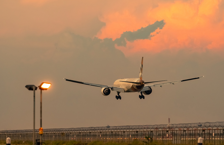 Passenger plane landing at airport. Photo Credit: Artinun Prekmoung | Dreamstime.com