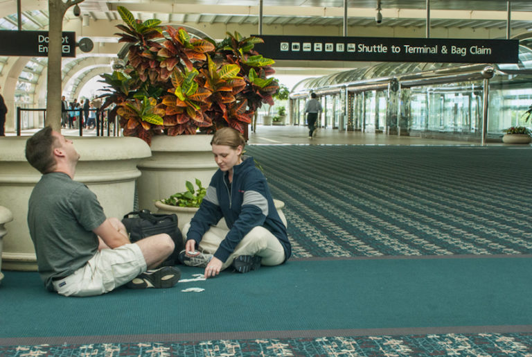 Couple on Airport floor waiting for flight