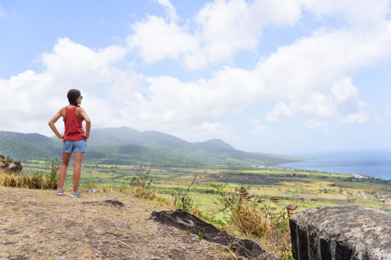 Hiking travel woman looking at St Kitts landscape