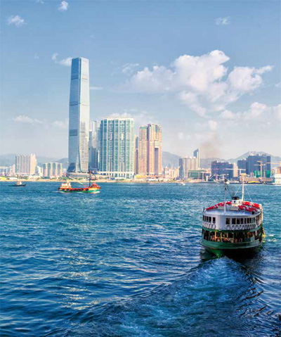 Star Ferry crossing the waters between Kowloon and Hong Kong Island